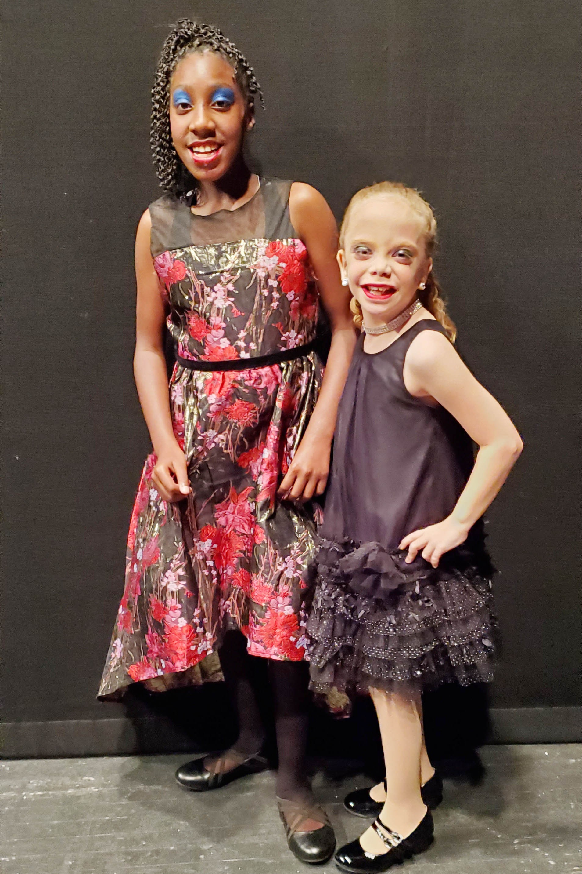 Both Olivia and Katherine enjoy dancing and performing during All Rhythm Dance Alley's dance recital.