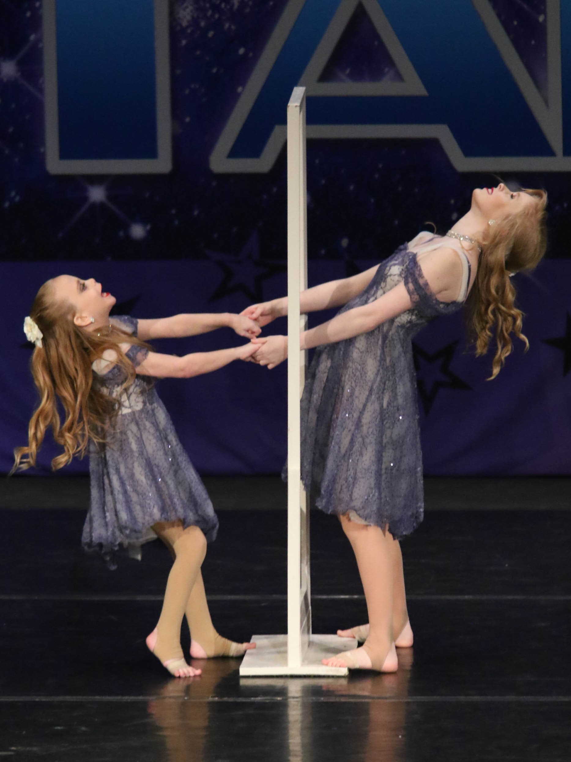 """During the 2018-2019 competition season, Katherine performed a duet with Heather Jaynes to """"Reflection"""" by Christina Aguilera. The meaning of the dance is that Katherine is looking at her reflection, which is actually Heather. This song was so sentimental to Katherine and her family because this is exactly what Katherine sees when she dances: no challenges or differences. The girls competed in the Teen Category and won Top 10 finishes including a first overall and special judges award."""