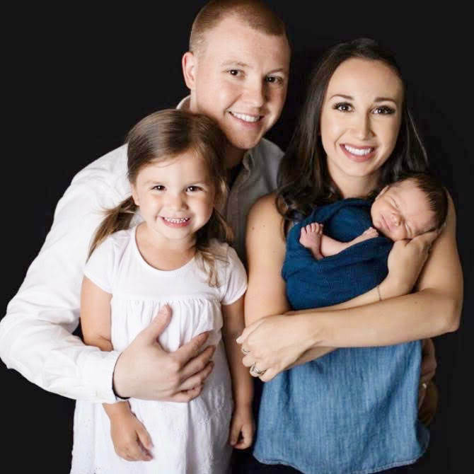Son, Ty and his wife, Alyssa, with their children, Rylee and Oliver.