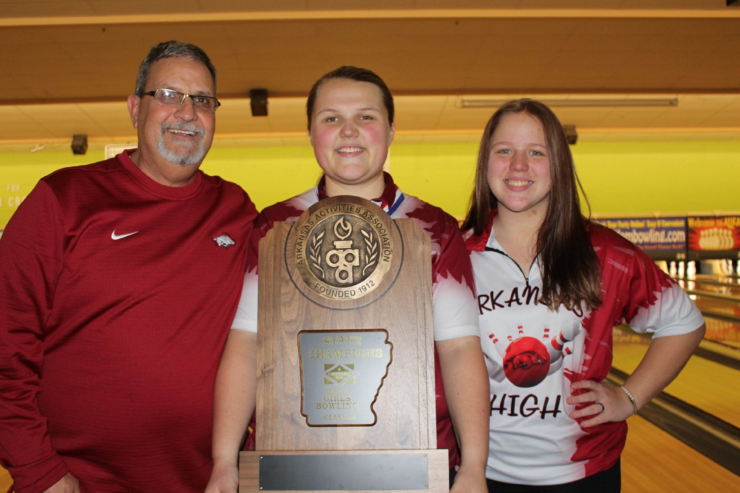For Linda, one of the best things about bowling is being able to go on this journey with her sister, Tricia, who is a junior at Arkansas High School. Here, the girls are pictured with Linda's coach, Roger Rico.