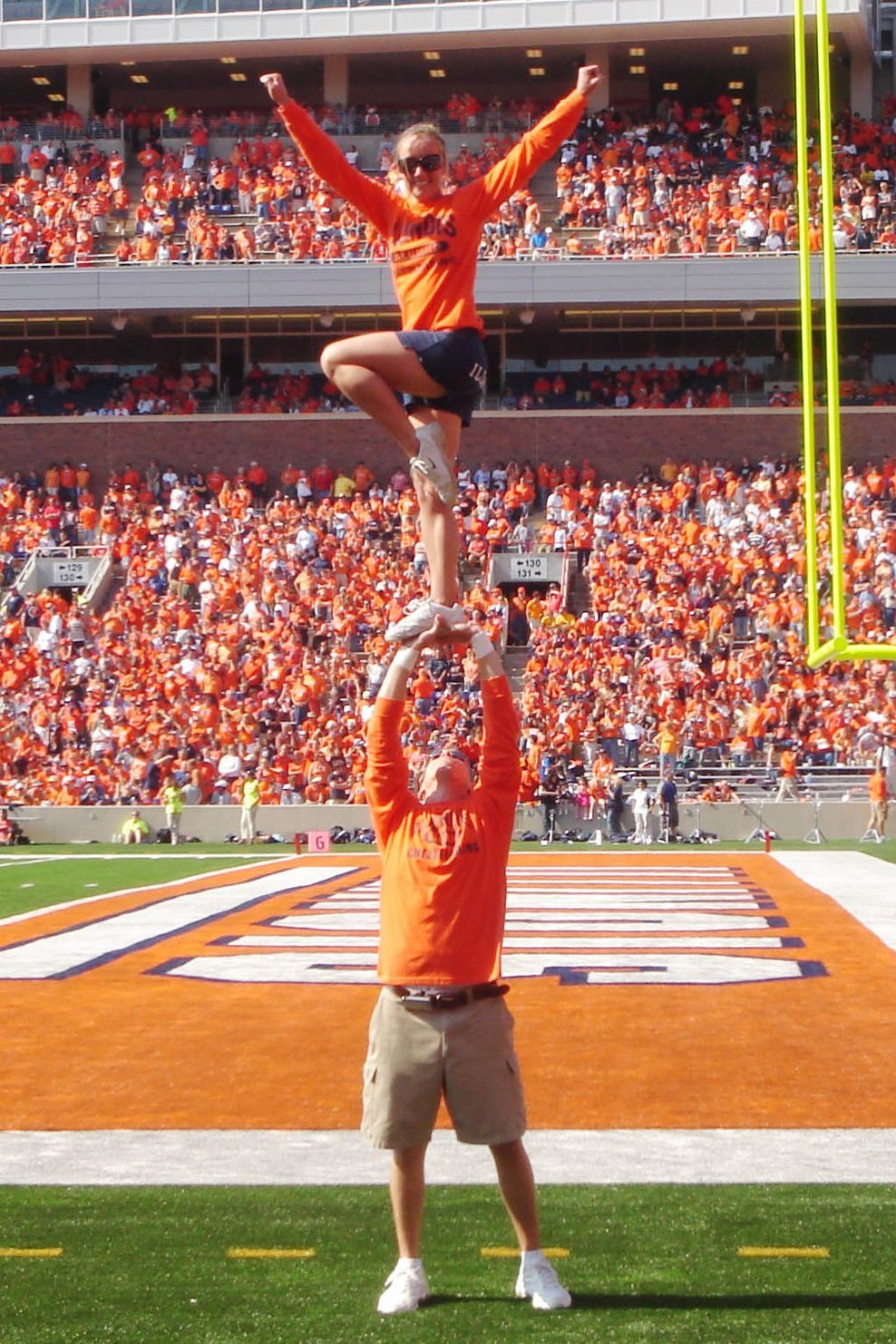 Jamie and Clara performing a stunt on the football field during the 2008 University of Illinois Homecoming game in Champaign, Illinois.
