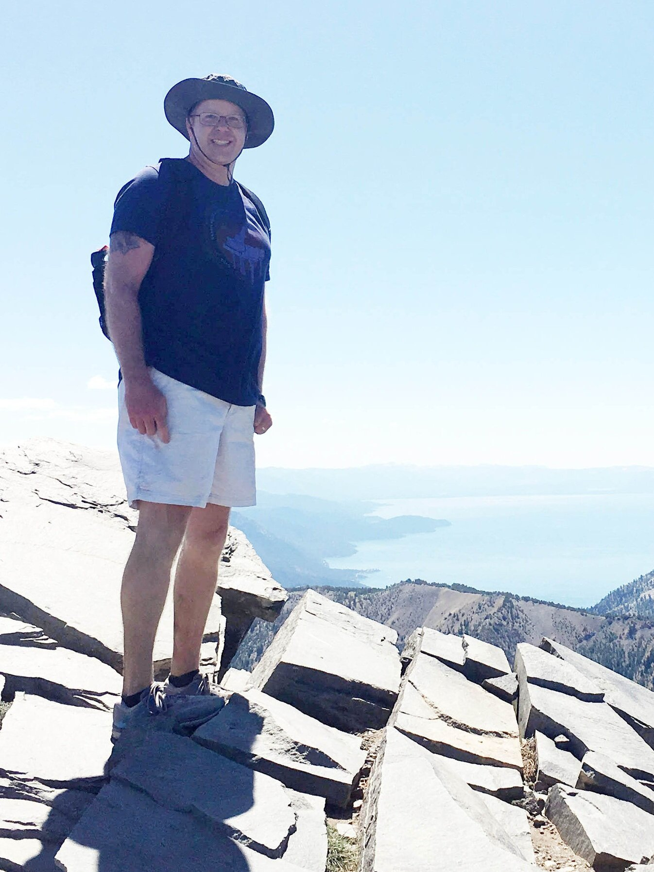 An adventure-seeker, Kevin stands at the Mt. Rose summit overlooking Lake Tahoe from 10,775 feet.