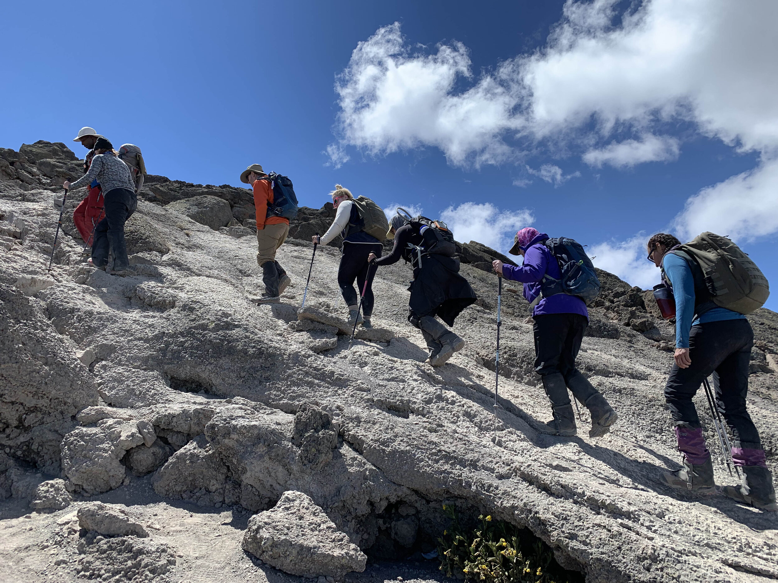 At 16,000 feet elevation, Deirdre Smith, Dr. Malcolm Smith, Ann Mancheski, Dr. Jennifer Thompson, Cheryl Kite and Melinda Krueger hike with their guide from Barafu Camp to Kosovo Camp, the day before summit day.