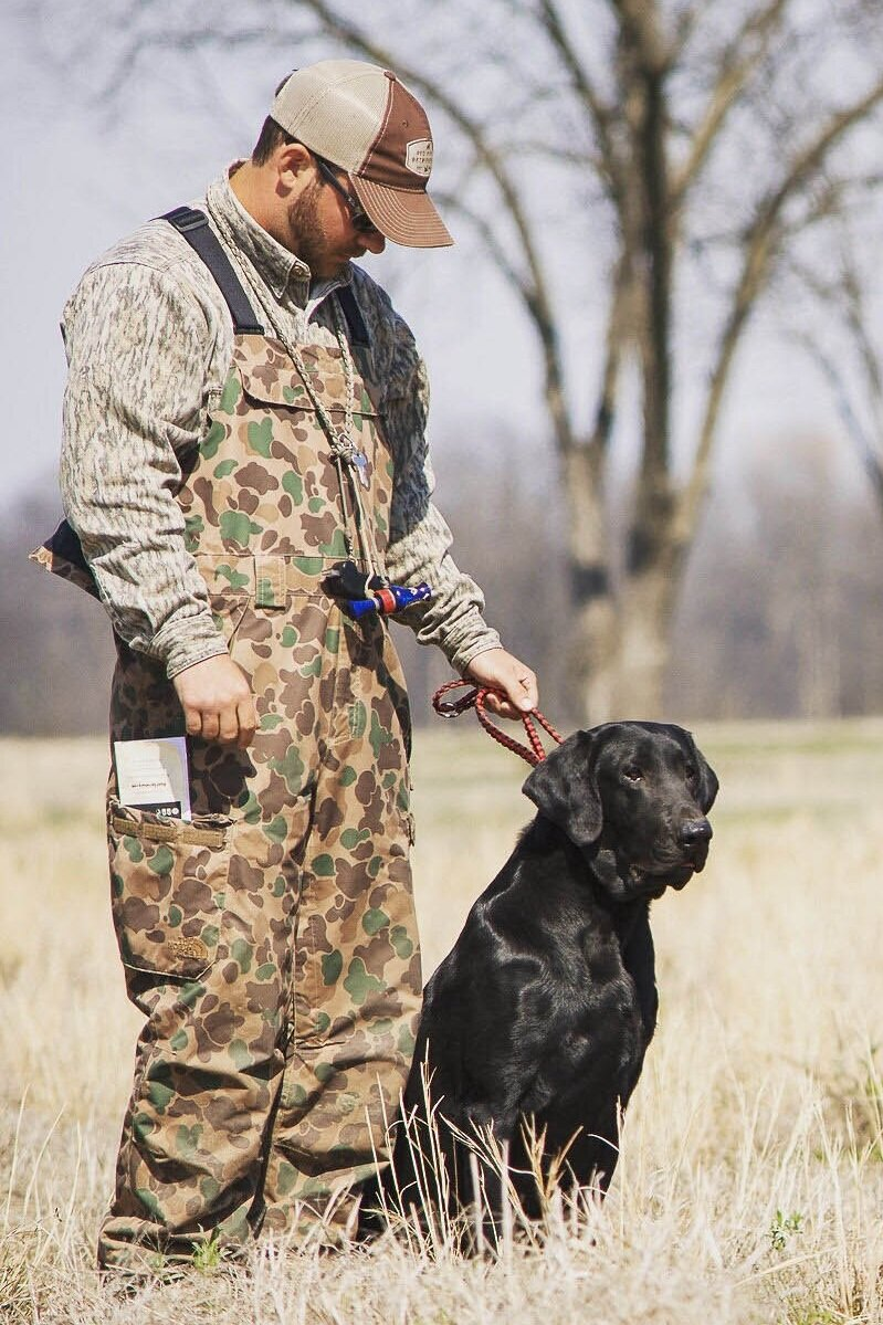 Lawson and Haggard watching for the next duck to launch during a hunt test in March 2017. (Photo by Kody Van Pelt)