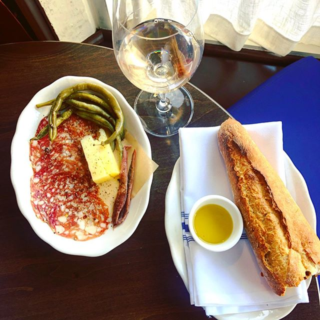 TGIF! Stop in and relax with this antipasti plate, house made pickles, @redtablemeatco soppressata, and a glass of this awesome White Pinot Noir from @westcoastwinesf #localitalian #tgif #relax #antipasti #happyhour #winetime #pinotnoir #charcuterie #snacks #snacktime