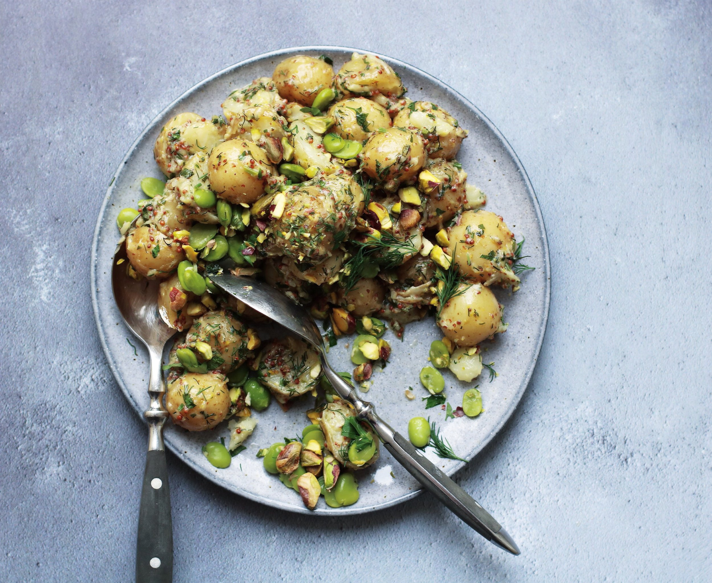 POTATO SALAD WITH BROAD BEANS AND PISTACHIOS   March-June.  A potato salad fit for spring when the Jersey Royals are in season. Topped with grainy mustard, crunchy pistachios and herby broad beans.