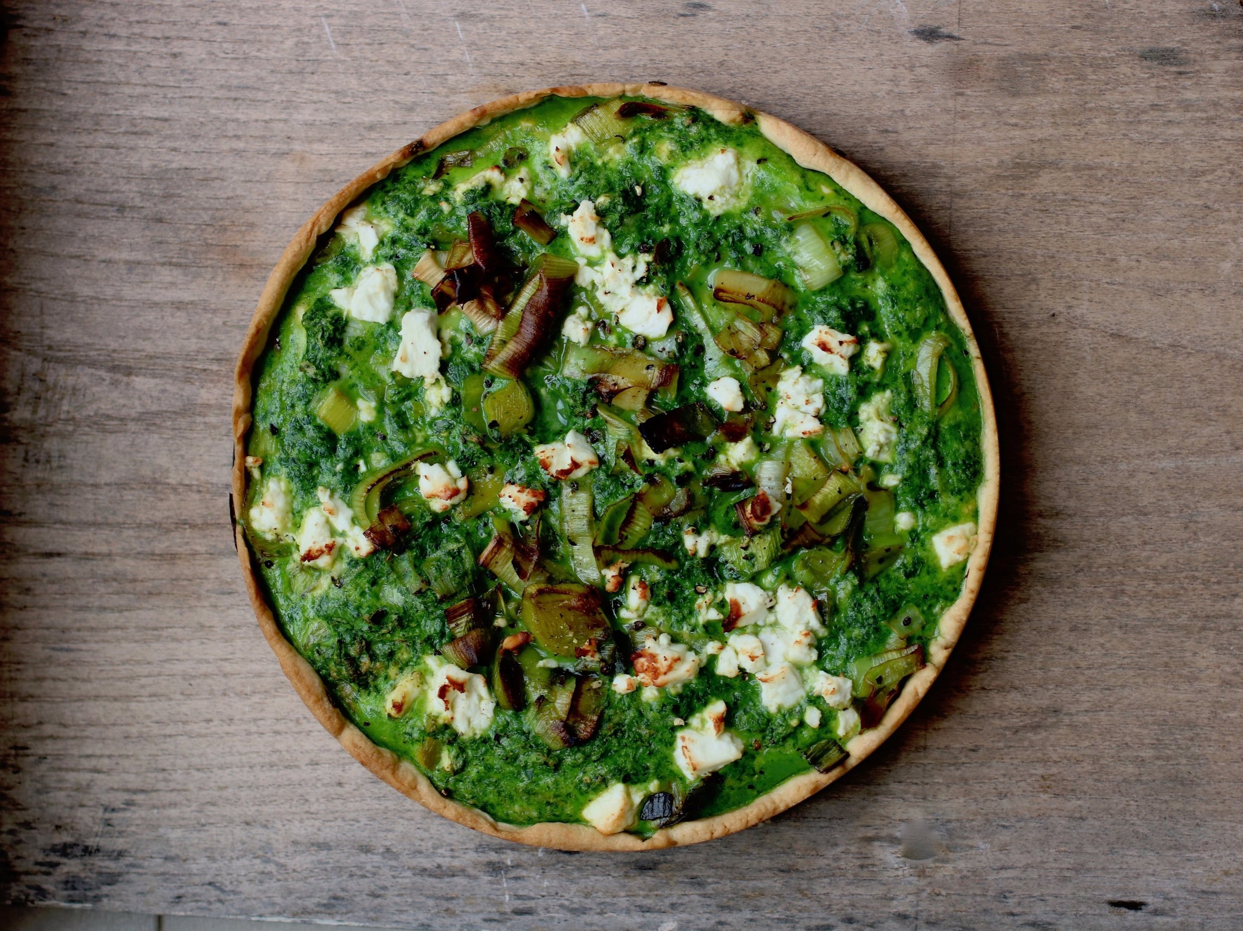 VERY GREEN TART   March-July.  This super quick recipe combines crispy leeks, vibrant spinach and crumbly feta make up this wonderfully healthy spring tart.