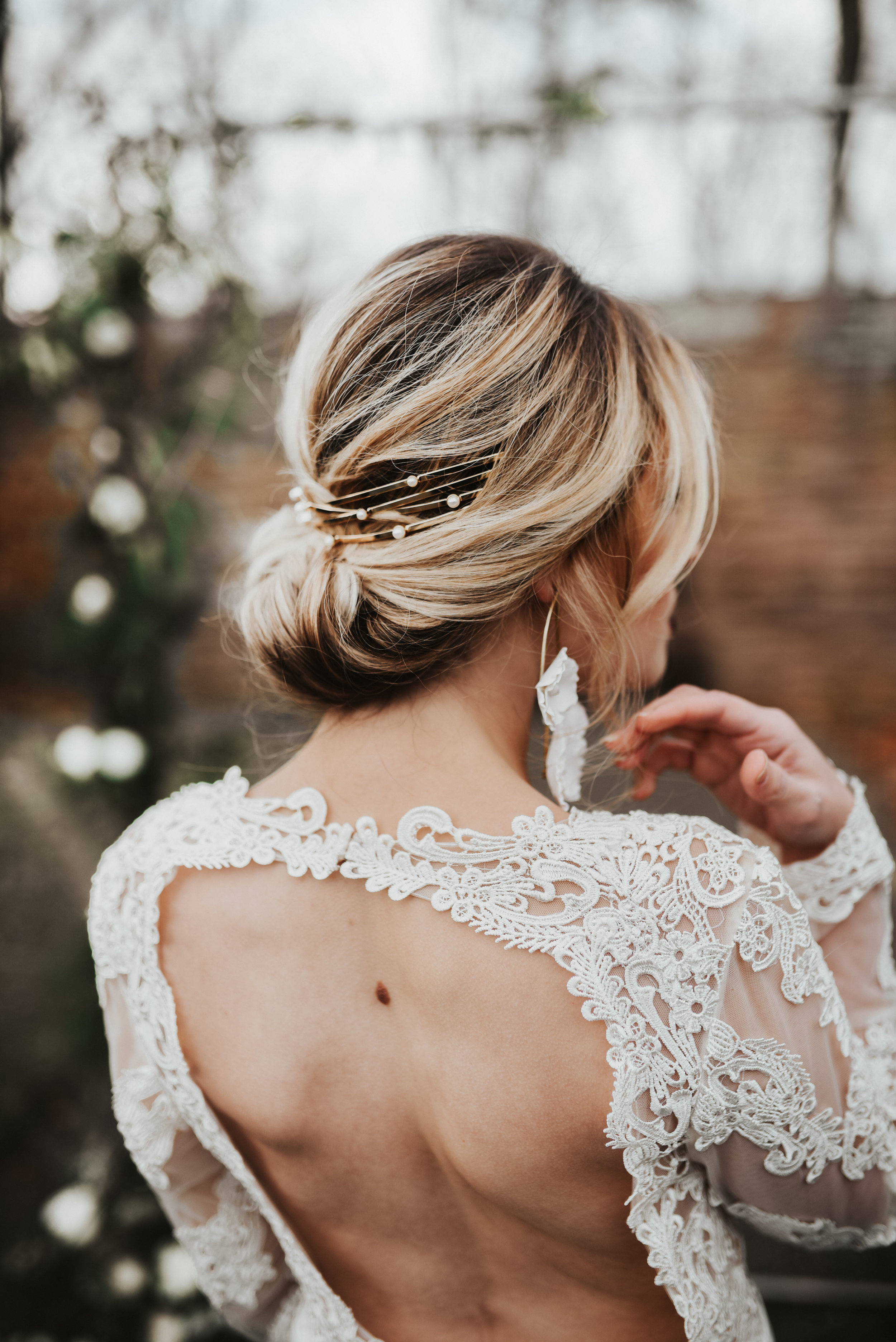 wedding hair style updo with accessory