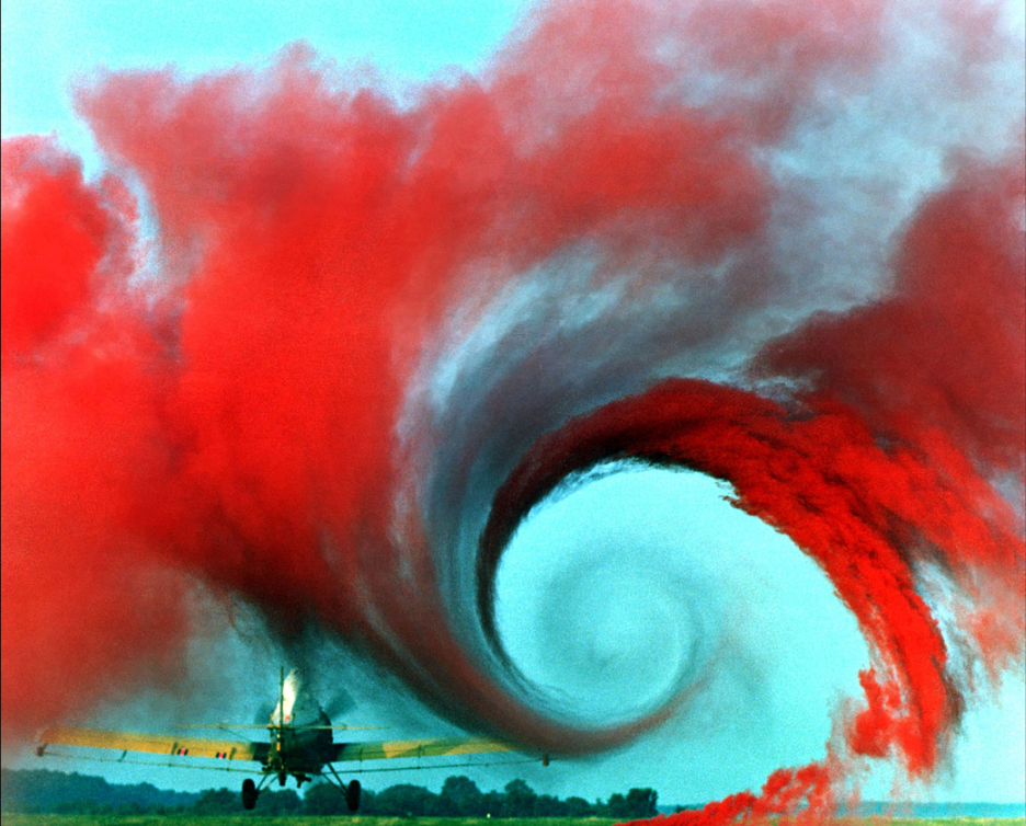 Vortex created by the passage of an  aircraft wing , revealed by colored smoke.