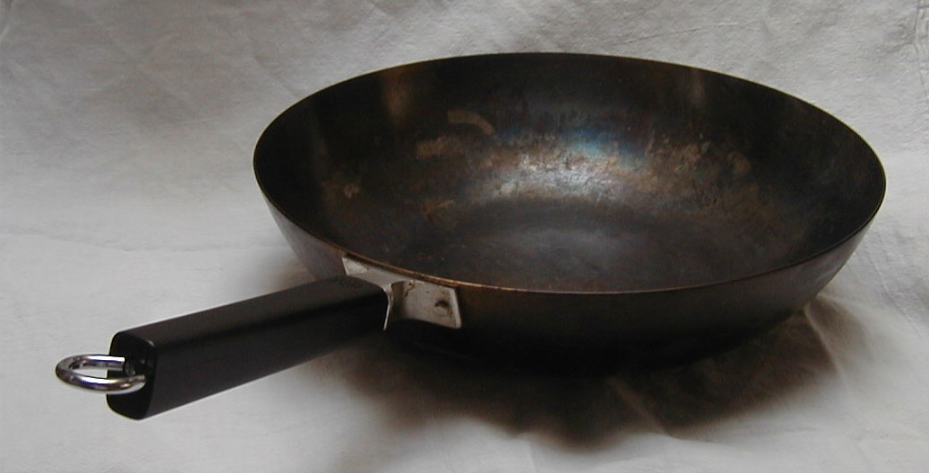 I use my wok primarily for boiling pasta. Water heats up much faster than a traditional pot and I like the way long-stranded pastas, spaghetti types, can lie flat across the top completely immersed in water from the get-go.