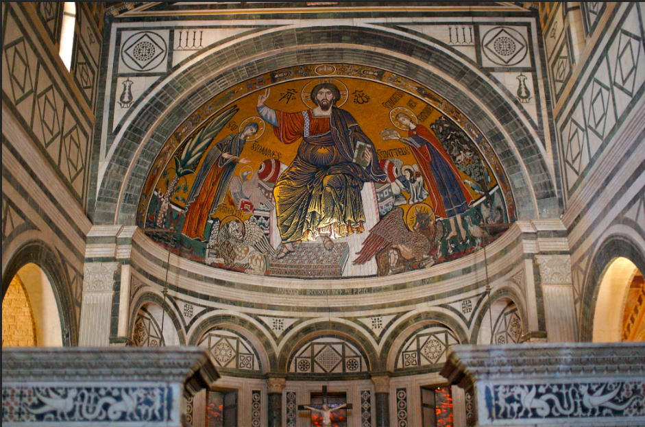 An interior shot of the Basilica San Miniato The mosaic depicting St. Miniato to the right of Christ holding a crown.  The inscription reads: S. MINIATUS REX ERMINIE.