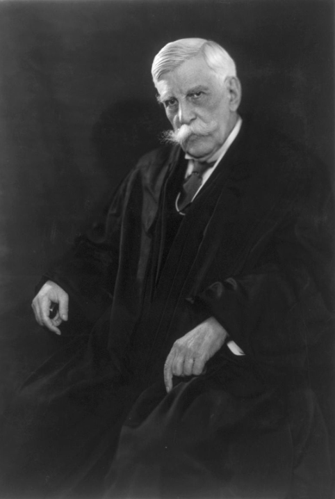 """Oliver Wendell Holmes Jr. (March 8, 1841 – March 6, 1935) was an American jurist who served as an Associate Justice of the Supreme Court of the United States from 1902 to 1932, and as Acting Chief Justice of the United States in January–February 1930.   Noted for his long service, his concise and pithy opinions, and his deference to the decisions of elected legislatures, he is one of the most widely cited United States Supreme Court justices in history, particularly for his """"clear and present danger"""" opinion for a unanimous Court in the 1919 case of Schenck v. United States, and is one of the most influential American common law judges, honored during his lifetime in Great Britain as well as the United States.   Holmes retired from the Court at the age of 90, making him the oldest Justice in the Supreme Court's history.   He also served as an Associate Justice and as Chief Justice on the Massachusetts Supreme Judicial Court, and was Weld Professor of Law at Harvard Law School, of which he was an alumnus.  In Buck v Bell the Supreme Court upheld a state statute instituting compulsory sterilization of the unfit """"for the protection and health of the state.""""  Carrie Buck was sterilized.  Holmes wrote the opinion of the Court. Despite these credentials, I do not believe any universities in Nazi Germany awarded him an honorary degree."""