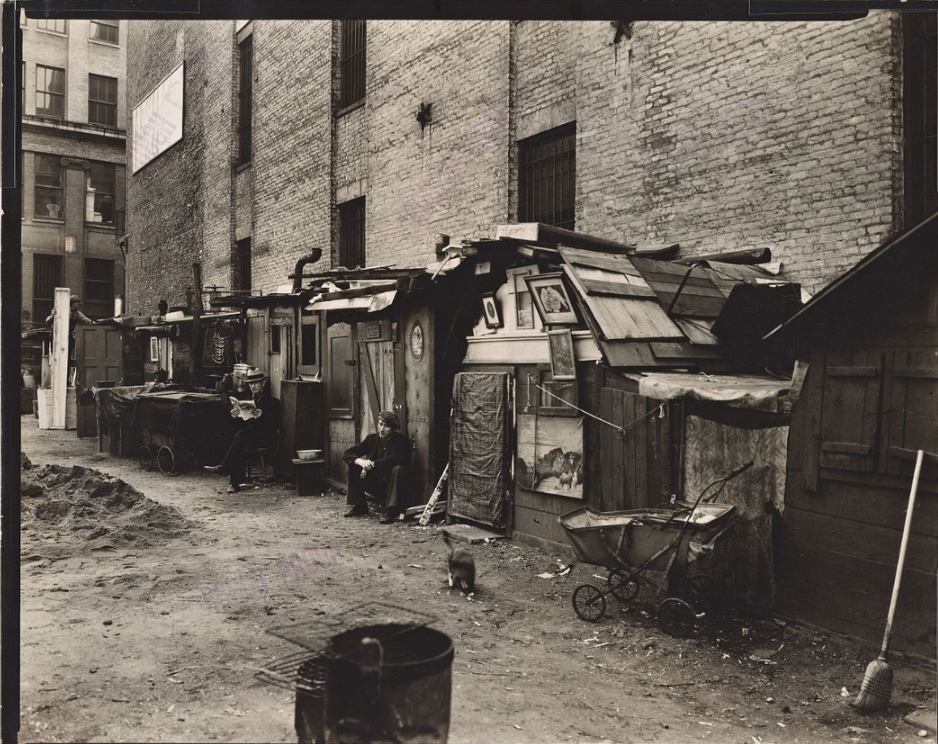 Huts and unemployed men in New York City, 1935    From Wikipedia and Berenice Abbott - https://digitalcollections.nypl.org/items/510d47d9-4fc1-a3d9-e040-e00a18064a99