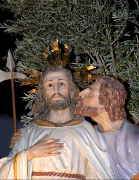 A red-haired Judas betrays Jesus with a kiss in a Spanish paso figure. Or betraying humanity.   Photo compliments of Wikipedia from the public domain. Adercilla - Own work