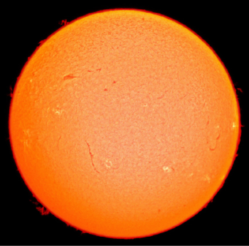 The Sun is the source of energy for most of life on Earth.  As a star, the Sun is heated to high temperatures by the conversion of nuclear binding energy due to the fusion of hydrogen in its core.  This energy is ultimately transferred (released) into space mainly in the form of radiant (light) energy.