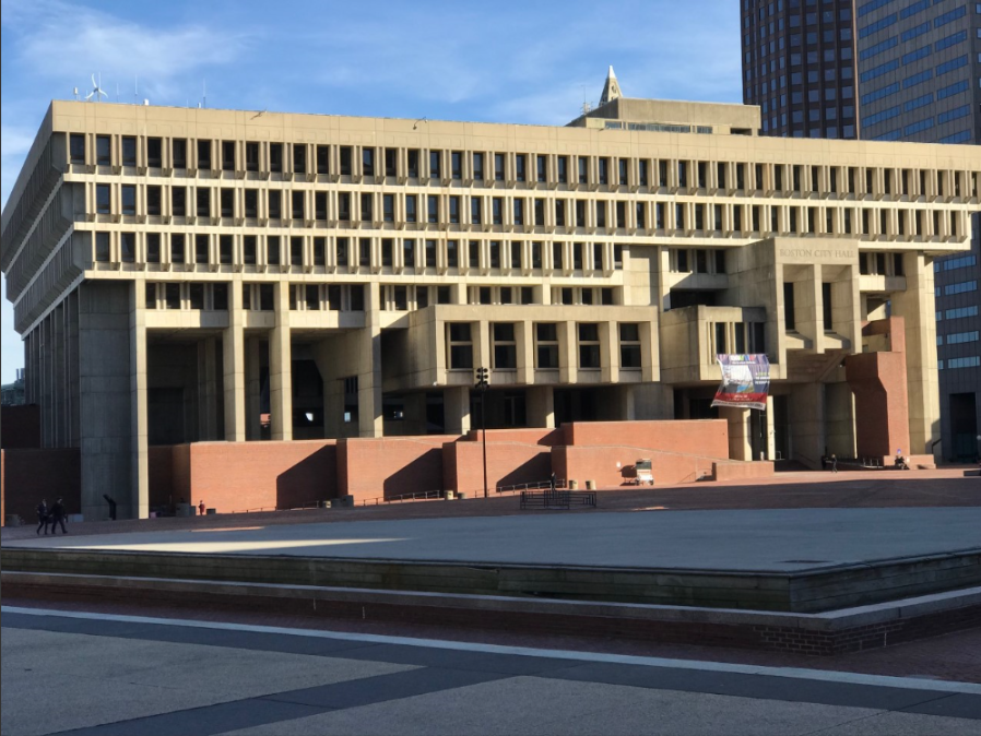 Boston City Hall is a powerful and muscular example of brutalist architecture. Must we dress it in a tutu?  Mr. Mayor, taker down that laundry. Please.