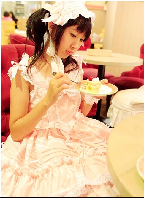 eating cake girl of 9 sad.png