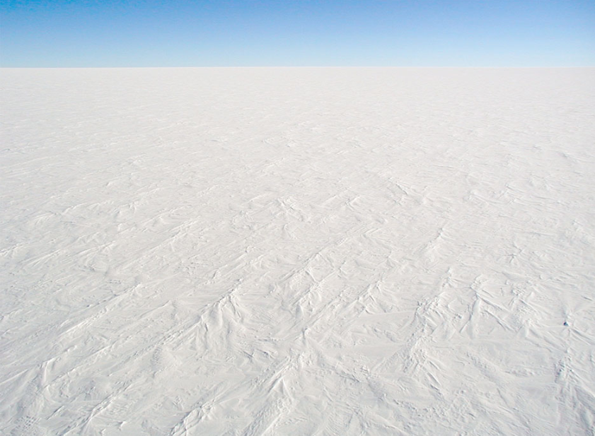 The coldest place on Earth is the Antarctic Plateau, an area of Antarctica around the South Pole that has an altitude of around 3,000 metres (9,800 ft).  The lowest reliably measured temperature on Earth of 183.9 K (−89.2 °C, −128.6 °F) was recorded there at Vostok Station on 21 July 1983. The Poles of Cold are the places in the Southern and Northern Hemispheres where the lowest air temperatures have been recorded.  The cold deserts of the North Pole, known as the tundra region, experiences an annual snow fall of a few inches and temperatures recorded are as low as −94 °F (−70 °C). Only a few small plants survive in the generally frozen ground (thaws only for a short spell).  The high, flat, and cold environment of the Antarctic Plateau at  Dome C  Stephen Hudson - Own work