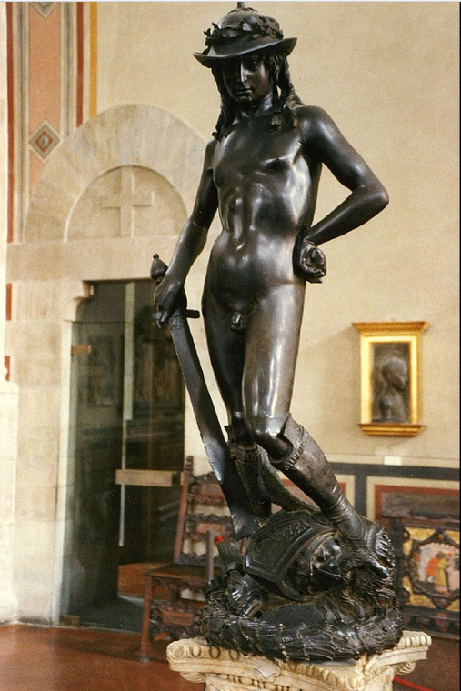 Donatello's second David  was a great hit when it was first unveiled in the 1440s. It was the first unsupported work to be cast in bronze of the Renaissance era. The statue's nakedness and implied homosexuality, with David clad no more that boots and a hat, made this work very controversial at the time.  Some historians have questioned if this statue does depict David, and suggest that the helmet is more reminiscent of the Greek or Roman messenger gods, Hermes or Mercury. Michelangelo rejected the pretty features, almost feminine face, budding breasts of a young girl.