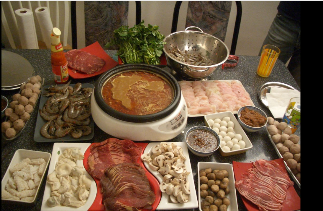 Hot pot is a Chinese cooking method, prepared with a simmering pot of soup stock at the dining table, containing a variety of East Asian foodstuffs and ingredients.  While the hot pot is kept simmering, ingredients are placed into the pot and are cooked at the table. Typical hot pot dishes include thinly sliced meat, leaf vegetables, mushrooms, wontons, egg dumplings, tofu, and seafood. The cooked food is usually eaten with a dipping sauce.