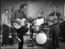 """Carl Perkins (2nd from left) performing """"Glad All Over"""" with (left to right) Clayton Perkins, W.S. """"Fluke"""" Holland, and Jay Perkins in the movie 'Jamboree.'"""