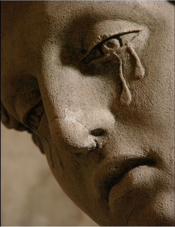 A detail of the 1672 sculpture Entombment of Christ, showing Mary Magdalene crying