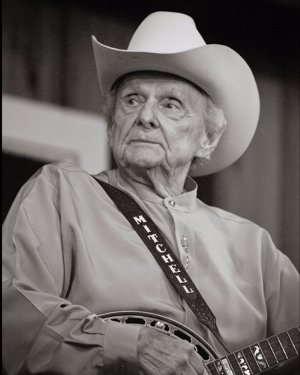 Image of Dr. Ralph Stanley taken by Reed George. Photo was taken during Stanley's appearance with his band, The Clinch Mountain Boys, at the 2011 Watermelon Park Festival in Berryville, VA. Image has been cropped, noise digitally removed, and lighting corrected from original.