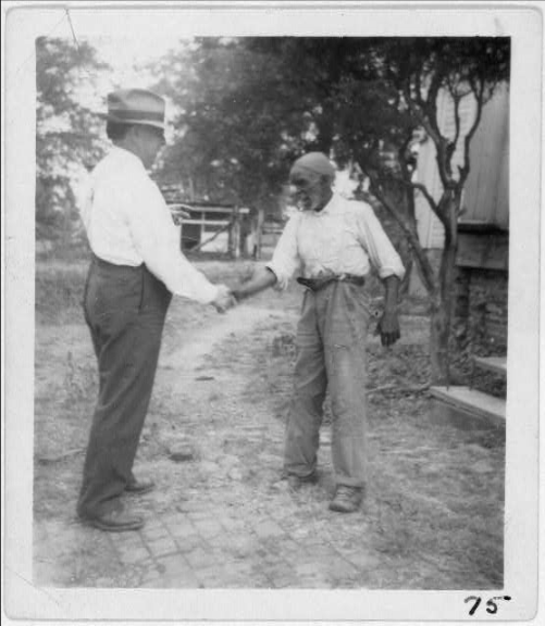 "Lomax (left) shaking hands with musician ""Uncle"" Rich Brown in 1940  John Avery Lomax (September 23, 1867 – January 26, 1948) was an American teacher, a pioneering musicologist, and a folklorist who did much for the preservation of American folk music.  He was the father of Alan Lomax (also a distinguished collector of folk music) and Bess Lomax Hawes."