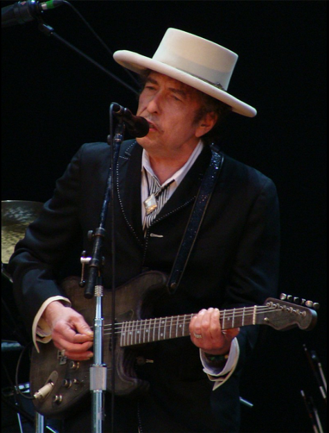 "Bob Dylan (born Robert Allen Zimmerman, May 24, 1941) is an American singer-songwriter, author, and artist who has been an influential figure in popular music and culture for more than five decades.  Much of his most celebrated work dates from the 1960s, when he became a reluctant ""voice of a generation"" with songs such as ""Blowin' in the Wind"" and ""The Times They Are a-Changin'"" which became anthems for the Civil Rights Movement and anti-war movement.  In 1965, he controversially ""went electric"", branching out from his earlier work and alienating some fans of the American folk music revival, recording a six-minute single, ""Like a Rolling Stone"", which enlarged the scope of popular music.  Dylan's lyrics incorporate a wide range of political, social, philosophical, and literary influences.  They defied existing pop-music conventions and appealed to the burgeoning counterculture. Initially inspired by the performances of Little Richard and the songwriting of Woody Guthrie, Robert Johnson, and Hank Williams, Dylan has amplified and personalized musical genres.  In his recording career, Dylan has explored many of the traditions in American song—from folk, blues, and country to gospel, and rock and roll, and from rockabilly to English, Scottish, and Irish folk music, embracing even jazz and the Great American Songbook.  Dylan performs on guitar, keyboards, and harmonica.  Backed by a changing lineup of musicians, he has toured steadily since the late 1980s on what has been dubbed ""the Never Ending Tour"".  His accomplishments as a recording artist and performer have been central to his career, but his songwriting is considered his greatest contribution.  Following his self-titled debut album in 1962, which mainly consisted of traditional folk songs, Dylan made his breakthrough as a songwriter with the release of the 1963 album The Freewheelin' Bob Dylan, featuring ""Blowin' in the Wind"" and the thematically complex composition ""A Hard Rain's a-Gonna Fall"", alongside several other enduring songs of the era.  For many of these songs he adapted the tunes and sometimes phraseology of older folk songs.  Dylan went on to release the politically charged The Times They Are a-Changin' and the more lyrically abstract and introspective Another Side of Bob Dylan in 1964.  In 1965 and 1966, Dylan encountered controversy when he adopted the use of electrically amplified rock instrumentation and in the space of 15 months recorded three of the most important and influential rock albums of the 1960s, Bringing It All Back Home, Highway 61 Revisited, and Blonde on Blonde."