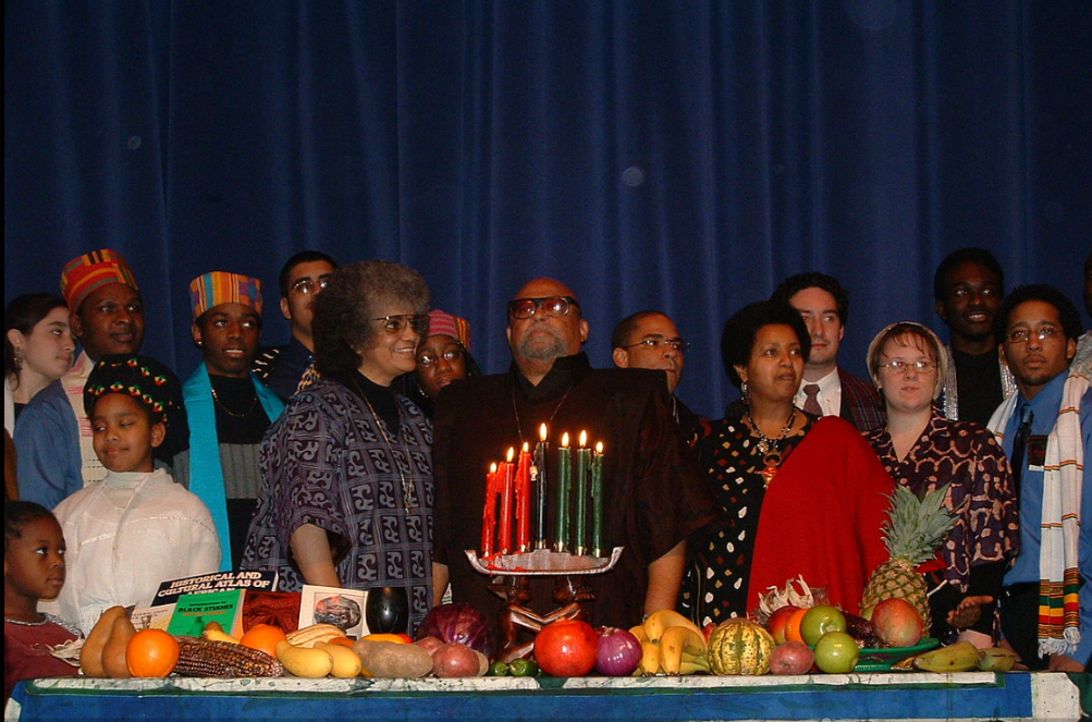 Karenga, center, with wife Tiamoyo at left, celebrating Kwanzaa at the Rochester Institute of Technology on December 12, 2003.