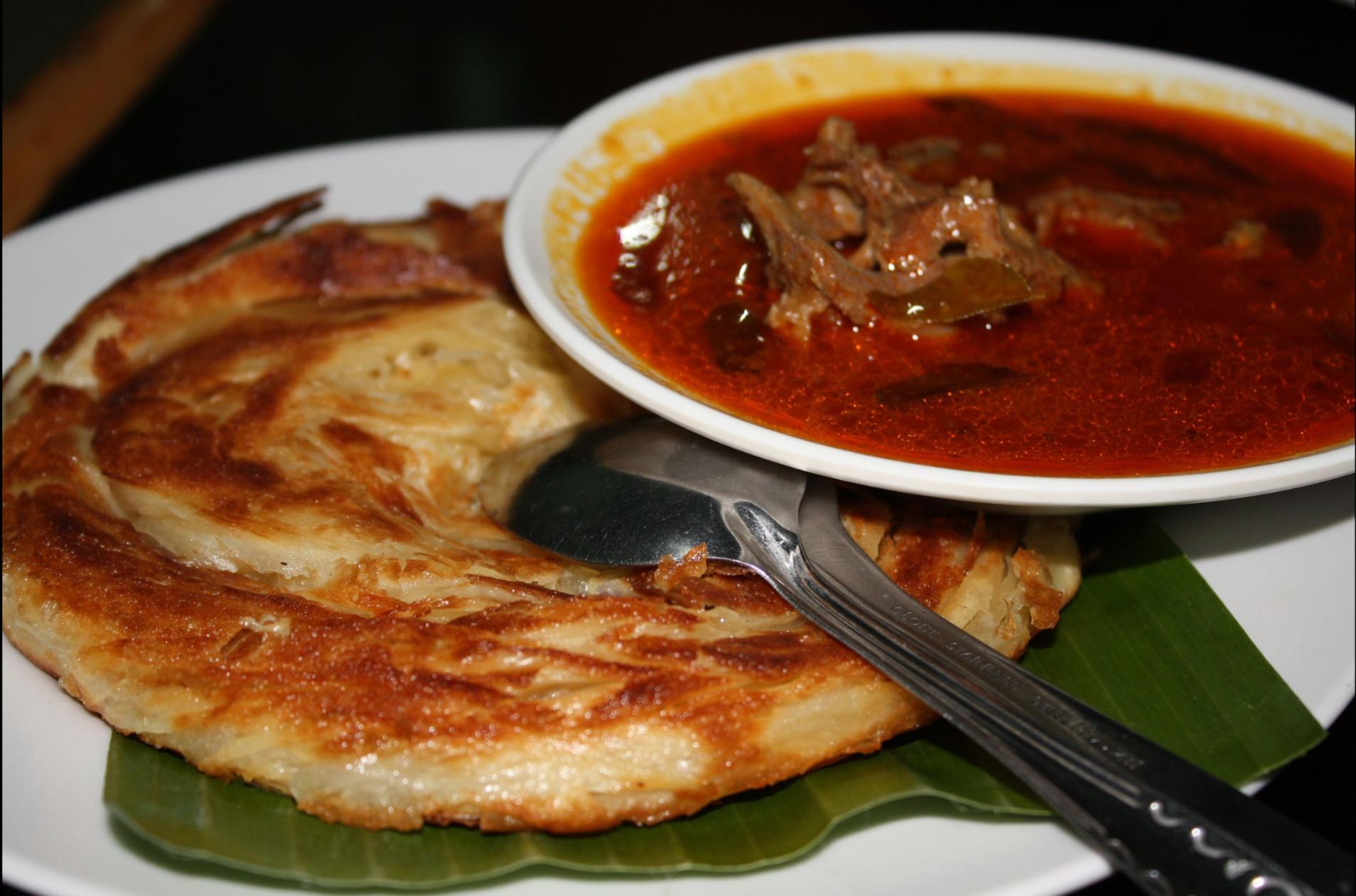 Kari kambing (mutton curry) served with roti canai in Sumatra.