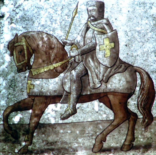 "A medieval mounted knight in armor  In the Medieval era, the knights took the ""peacock vow"" at the end of the Christmas season each year to re-affirm their commitment to chivalry."
