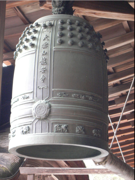 Bonshō (Japanese: 梵鐘, Buddhist bells), also known as tsurigane (釣り鐘, hanging bells) or ōgane (大鐘great bells) are large bells found in Buddhist temples throughout Japan, used to summon the monks to prayer and to demarcate periods of time.  Rather than containing a clapper, bonshō are struck from the outside, using either a handheld mallet or a beam suspended on ropes.  The bells are usually made from bronze, using a form of expendable mould casting.  They are typically augmented and ornamented with a variety of bosses, raised bands and inscriptions. The earliest of these bells in Japan date to around 600 CE, although the general design is of much earlier Chinese origin and shares some of the features seen in ancient Chinese bells.  The bells' penetrating and pervasive tone carries over considerable distances, which led to their use as signals, timekeepers and alarms.  In addition, the sound of the bell is thought to have supernatural properties; it is believed, for example, that it can be heard in the underworld.  The spiritual significance of bonshō means that they play an important role in Buddhist ceremonies, particularly the New Year and Bon festivals.  Throughout Japanese history these bells have become associated with stories and legends, both fictional, such as the Benkei Bell of Mii-dera, and historical, such as the bell of Hōkō-ji.  In modern times, bonshō have become symbols of world peace.