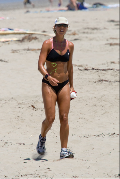 A woman jogging at a beach in the U.S. to maintain/improve her physical fitness  Mike Baird - Flickr: Female jogger with good tan jogging - Scenes from Morro Bay, CA