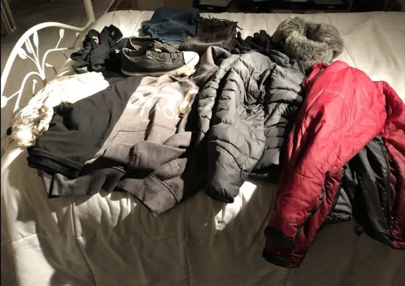 My allies, of which I am greatly fond. To the front left are my white thermal undershirt, smart-wool sweater, black, and a grey cotton Sergio Tacchini warm-up sweater with hood, very warm indeed. TWO winter jackets, the grey fits me; the red fitted me when I was 35 pounds heavier. I kept the jacket and now use it as an overcoat on these very cold days. To the rear left are TWO pairs of socks and sneakers. Then my jeans concealing, mostly, my underwear, then comes my scarf and TWO pairs of gloves. And the piece de resistance, a very warm fur hat which I put on over my hood. That is enough for Mother Nature whatever her mood. Mostly.