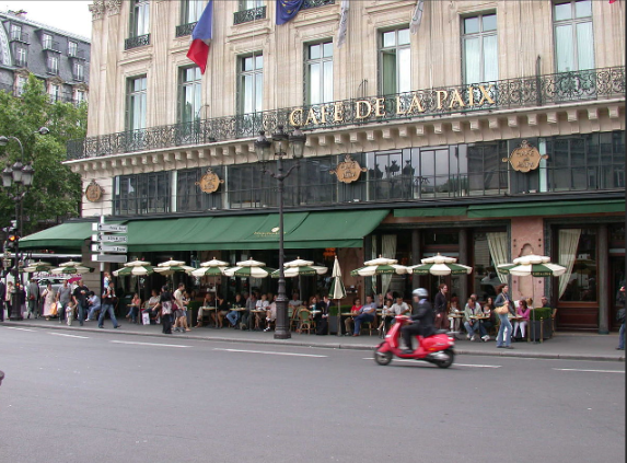 The Eiffel Tower? No. The iconic image of Paris are the ubiquitous cafes.