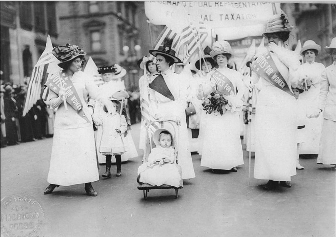 My mother at eight months old. Leading a suffragette parade. Not.