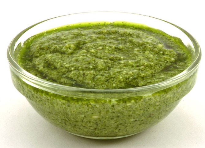 Pesto is a sauce originating in Genoa, the capital city of Liguria, Italy. It traditionally consists of crushed garlic, European pine nuts, coarse salt, basil leaves, Parmigiano-Reggiano (Parmesan cheese) and Pecorino Sardo (cheese made from sheep's milk), all blended with olive oil.