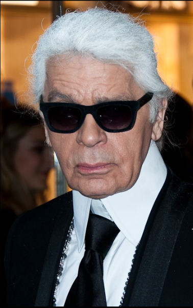 Karl Lagerfeld at a Fendi store opening Christopher William Adach - https://www.flickr.com/photos/adach/14071166986/   He was well recognized around the world for his white hair, black sunglasses, fingerless gloves, and high starched collars.