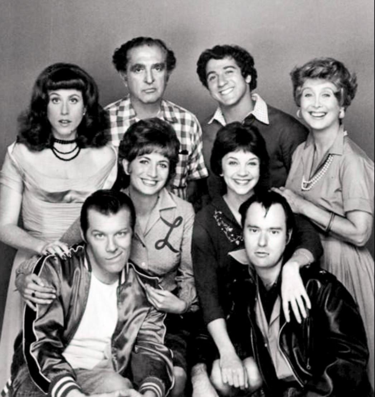 Cast photo, 1976.  Standing, L–R:  Carole Ita White ,  Phil Foster ,  Eddie Mekka ,  Betty Garrett . Middle row, standing:  Penny Marshall ,  Cindy Williams .  Seated:  Michael McKean ,  David Lander .