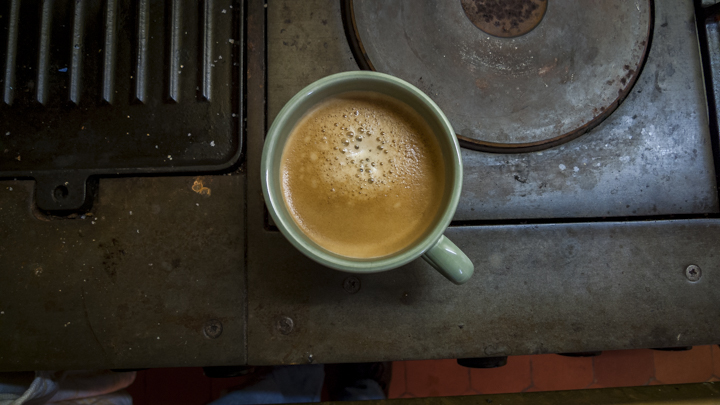 My favorite cuppa joe when I'm in France. A café Amèricain in my own kitchen, from a Nespresso machine… shown here sitting on my ancient Godin stove, the Chatelaine model.  photo © Howard Dinin.
