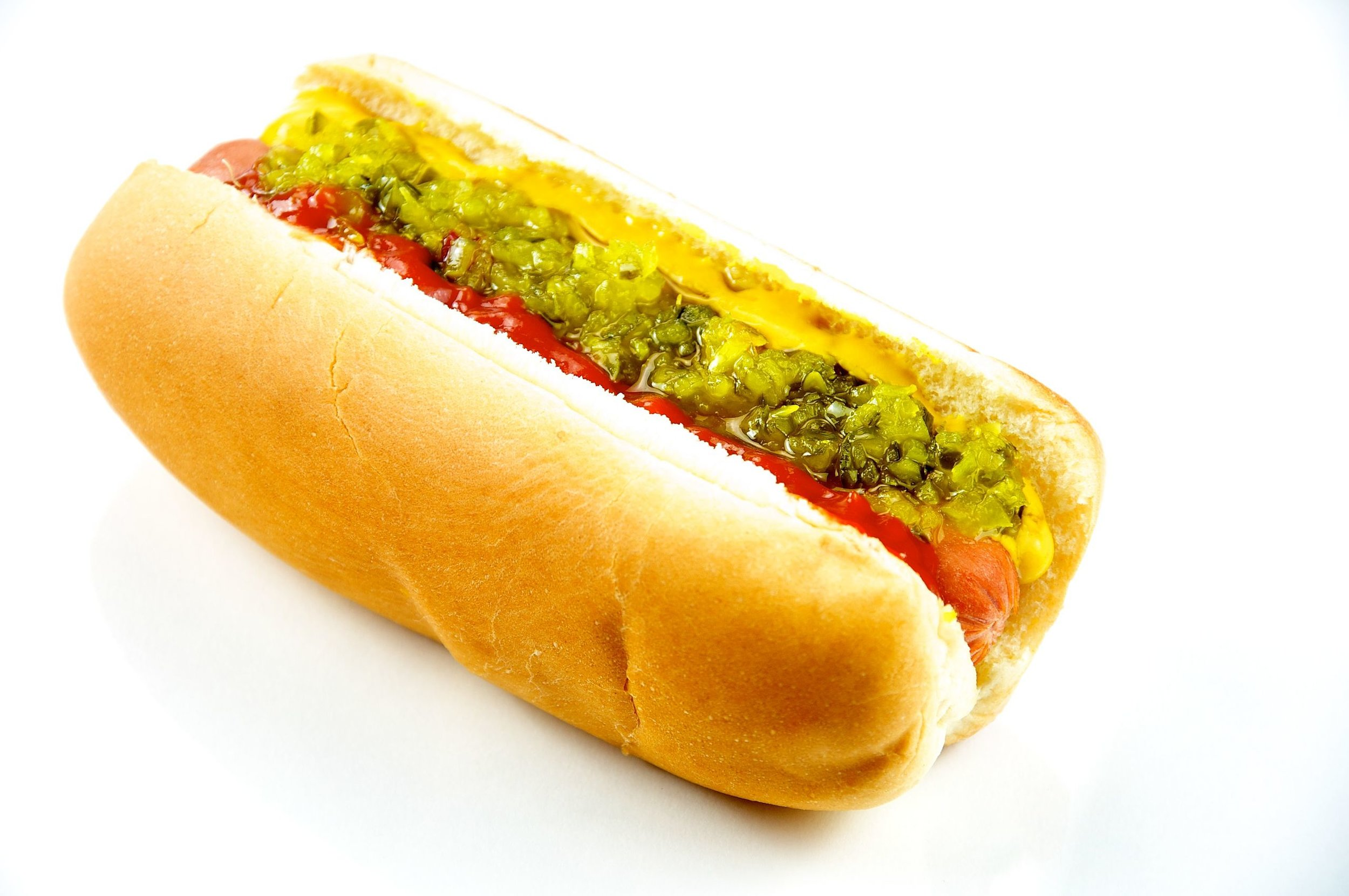 A cooked hot dog in a bun with mustard, relish, and ketchup Hot Dog Evan Swigart from Chicago, USA - Hot