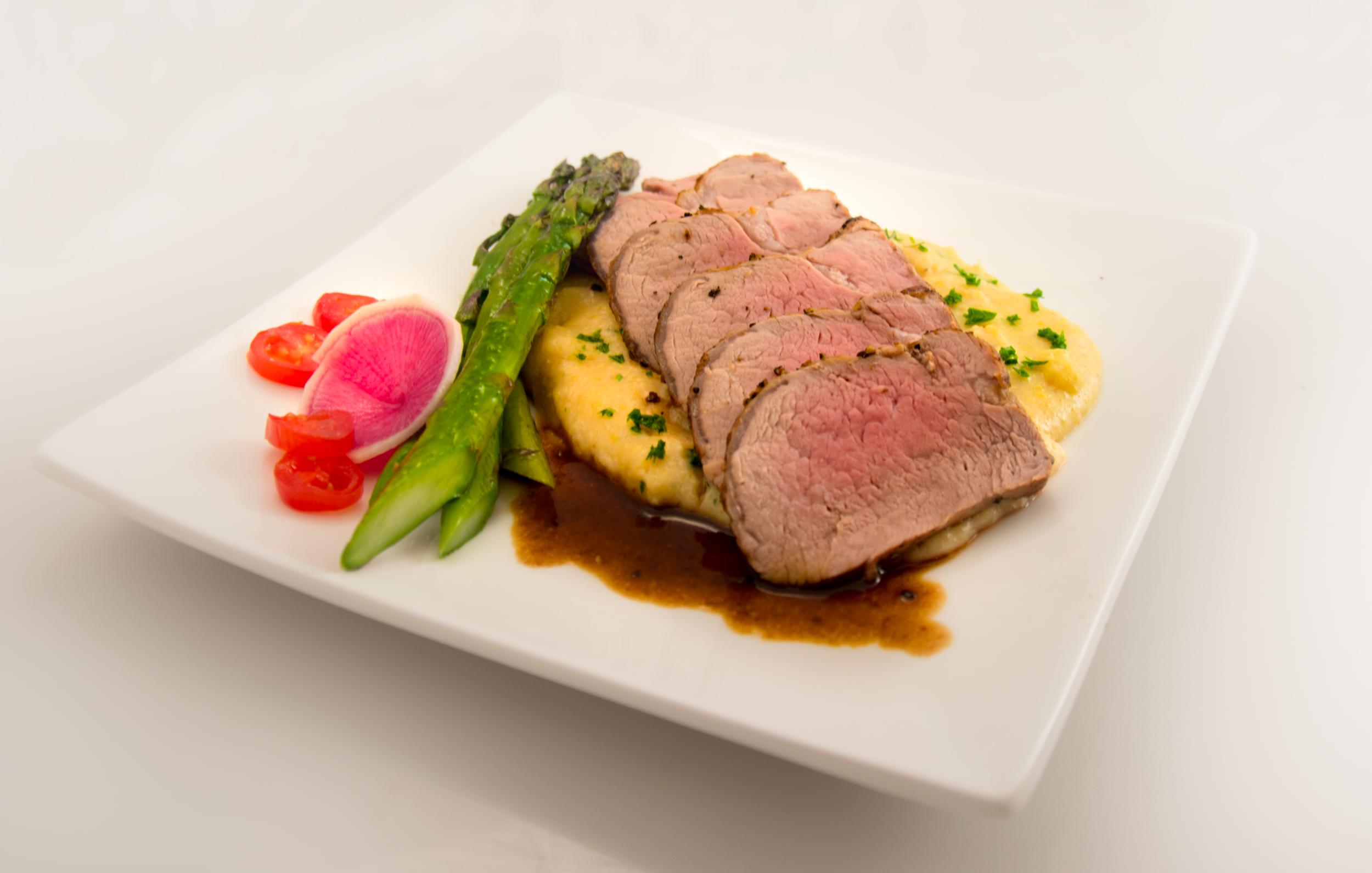 Roast pork tenderloin slices in an entrée  User:Ɱ  - Own work