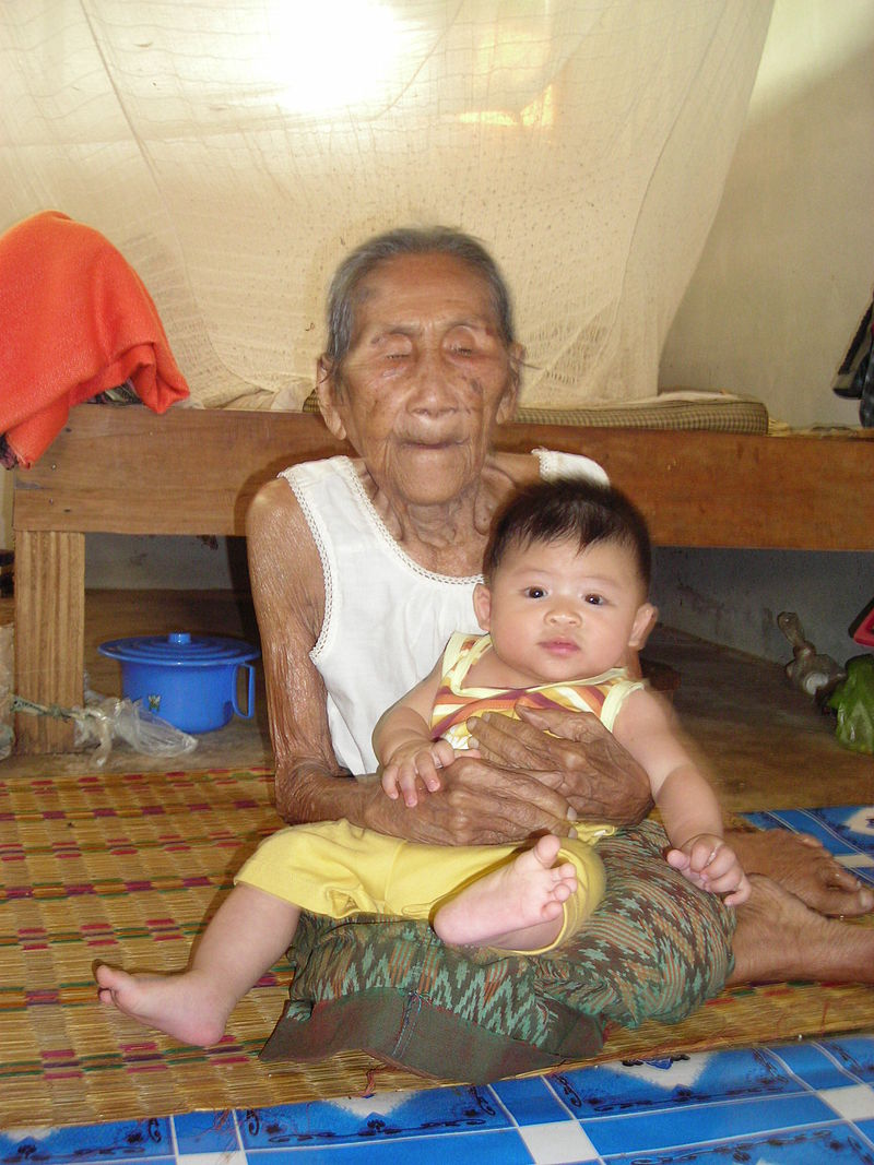 95-year-old woman holding a five-month-old boy User:Mattes - Own work