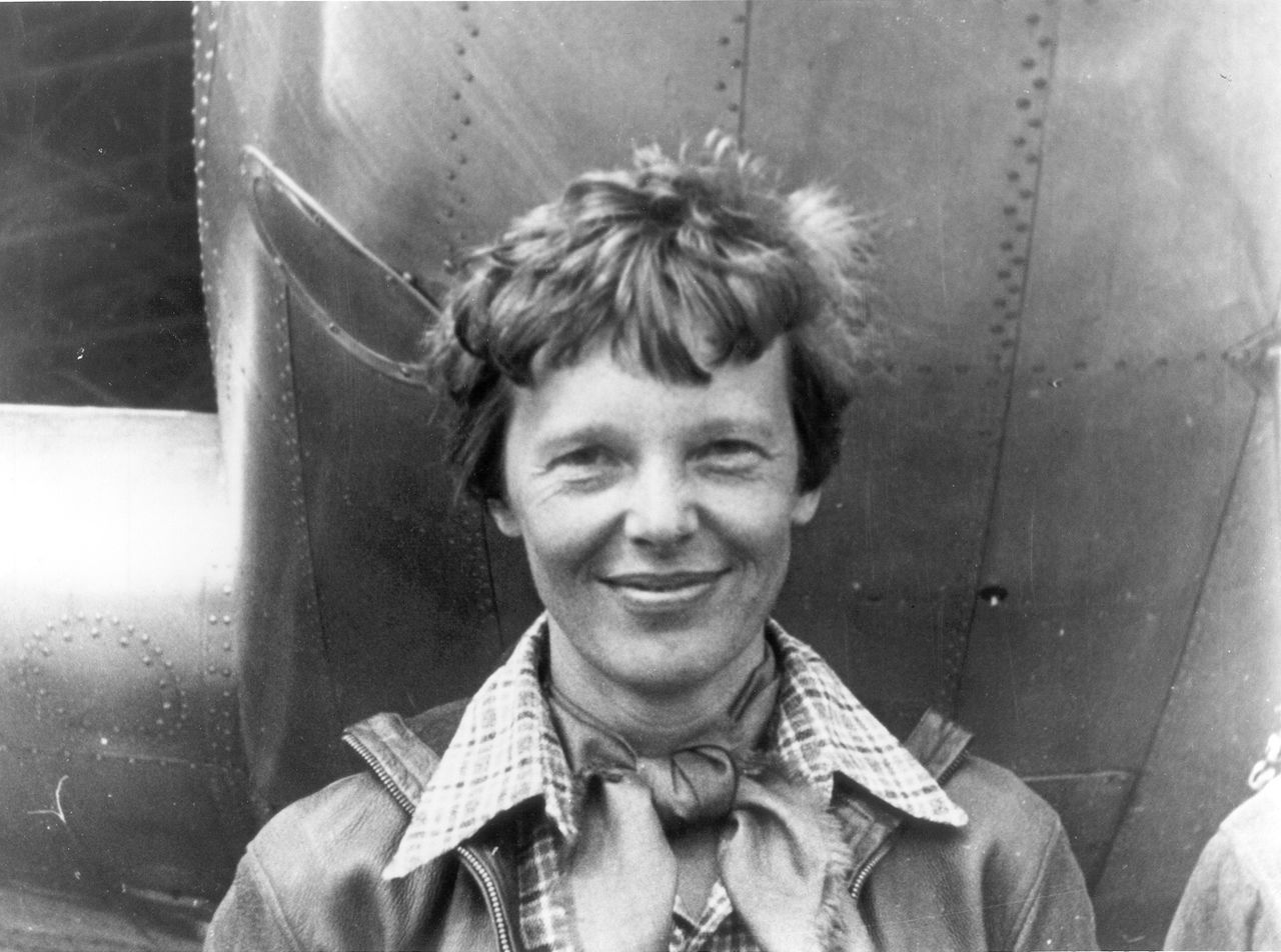 Amelia Earhart standing under nose of her Lockheed Model 10-E Electra. Gelatin silver print, 1937. National Portrait Gallery, Smithsonian Institution;  gift of George R. Rinhart, in memory of Joan Rinhart Underwood & Underwood (active 1880 – c. 1950)[1] - http://amextbg2.wgbhdigital.org/wgbh/americanexperience/media/uploads/special_features/photo_gallery/amelia_gallery_07.jpg
