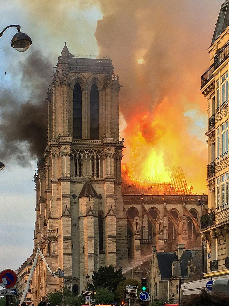 The building on fire on 15 April 2019 LeLaisserPasserA38 - Own work Feu dans la charpente de Notre Dame.