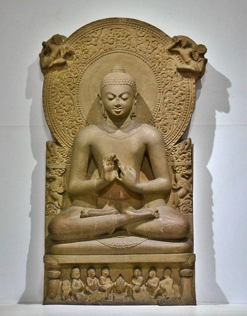 Cinematographer The statue in 1905 at the time of its discovery (to the right of the photograph). Seated Buddha; circa 475; sandstone; height: 1.6 m (5 ft. 3 in.); Sarnath Museum (India). This figure, his hands in the  dharmachakra mudra  gesture of teaching, refers to the Buddha's first sermon at Sarnath, where the figure was found.  พระมหาเทวประภาส วชิรญาณเมธี (ผู้ถ่าย-ปล่อยสัญญาอนุญาตภาพให้นำไปใช้ได้เพื่อการศึกษาโดยอยู่ภา่ยใต้ cc-by-sa-3.0)  ผู้สร้างสรรค์ผลงาน/ส่งข้อมูลเก็บในคลังข้อมูลเสรีวิกิมีเดียคอมมอนส์  - เทวประภาส มากคล้าย - Tevaprapas Makklay (พระมหาเทวประภาส วชิรญาณเมธี)