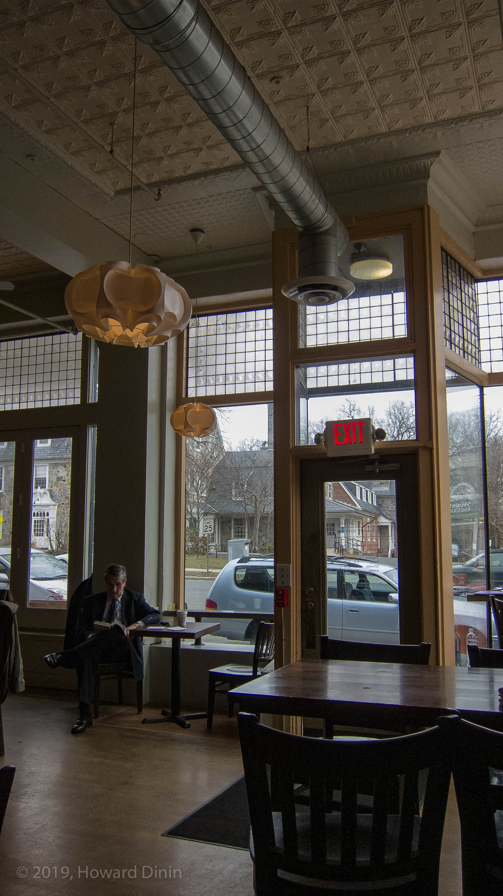 Amherst Coffee reveals its pensive potentialities. The mark of a great coffee house is the extent it can accommodate your frame of mind, and your disposition of the moment. With nothing, the light, the decor, the serving ware, either insufficient or obtrusive. image: © Howard Dinin.
