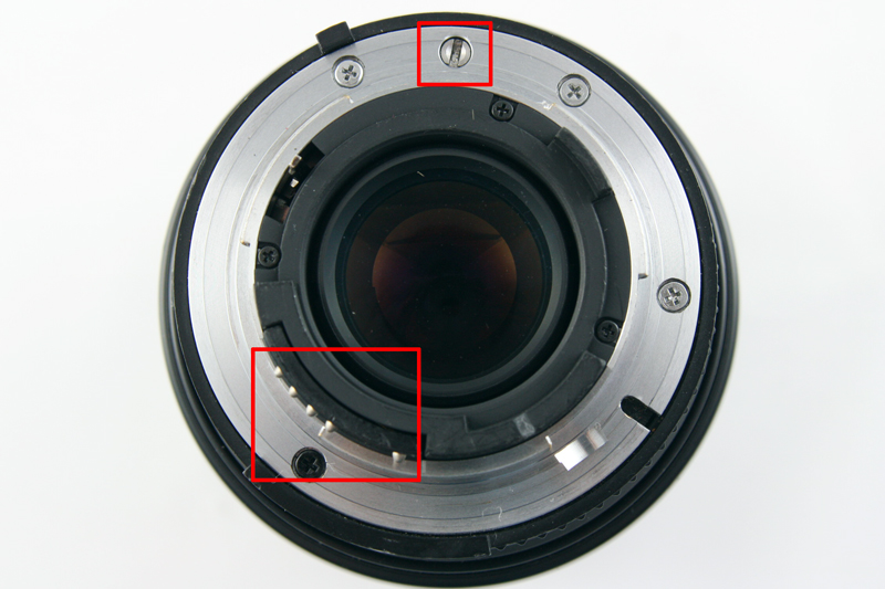 The AF mount introduces electronic contacts for communicating information between lens and camera seen in the lower left as well as a coupling for the auto-focus motor.