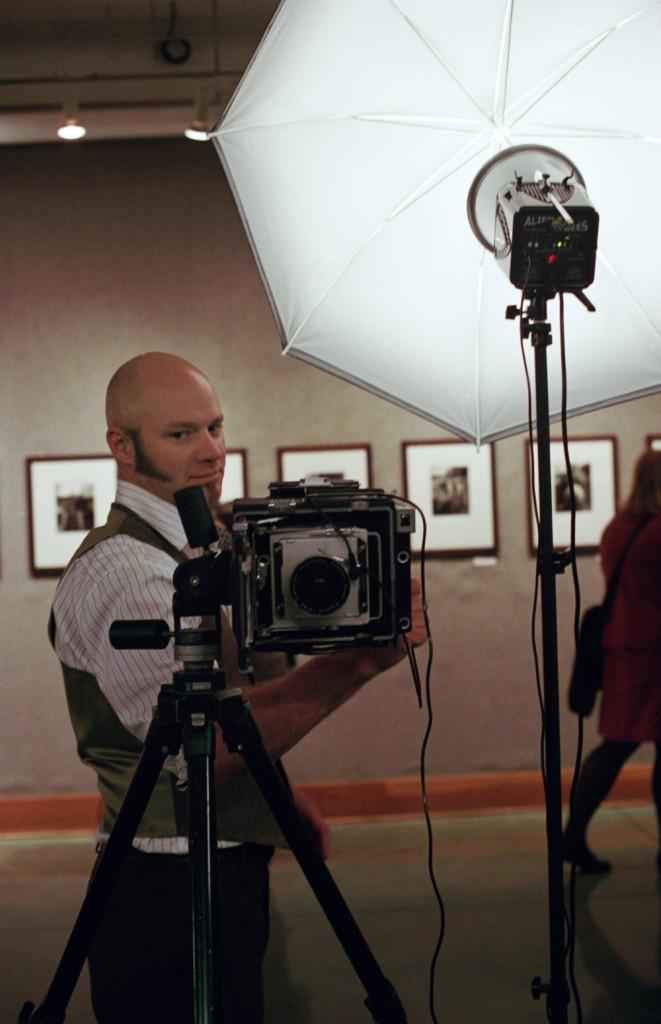 Jason Kelley runs a 4×5 Graphic powered photo booth at Powell's (Photo by Katt Janson)